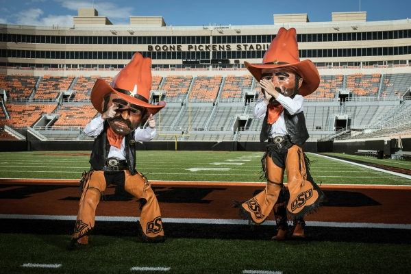 Austin Johnson, left, and Taylor Collins perform as Oklahoma State Cowboy's mascot Pistol Pete